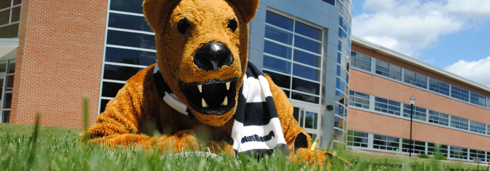Nittany Lion mascot and olmsted building